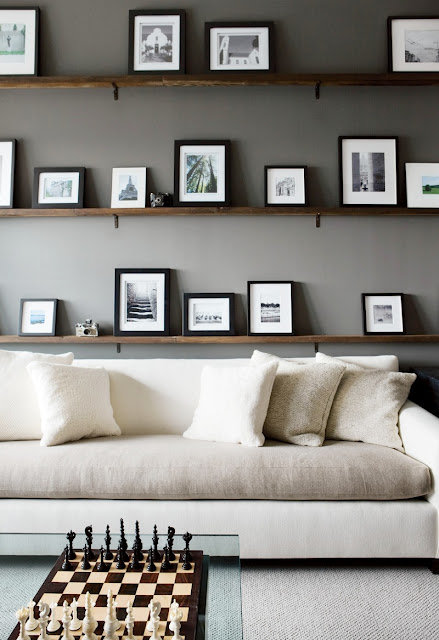 atlanta homes gardens dark gray office white two toned sectional chess board floating picture shelves cococozy