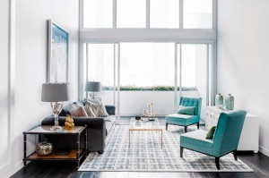 loft apartment brendan wong living room turquoise blue chairs gray sofa geometric rug